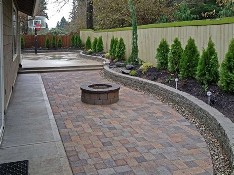 backyard paver patio connected to a concrete slab