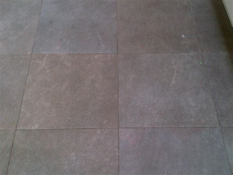 Cleaning Porous Floor Tiles by Cleaning Micro Porous Textured Porcelain Tiles In A