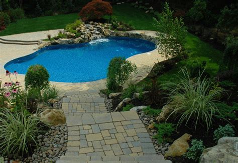 backyard oasis destination swimming pool deck and patio design builds