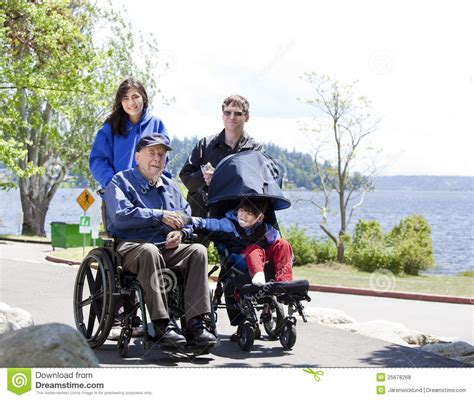 Free Barn Plans Family With Disabled Senior And Child Outdoors Stock Photo