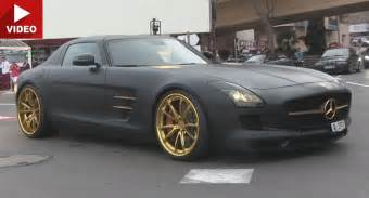 matte black mercedes sls amg with gold accents tears