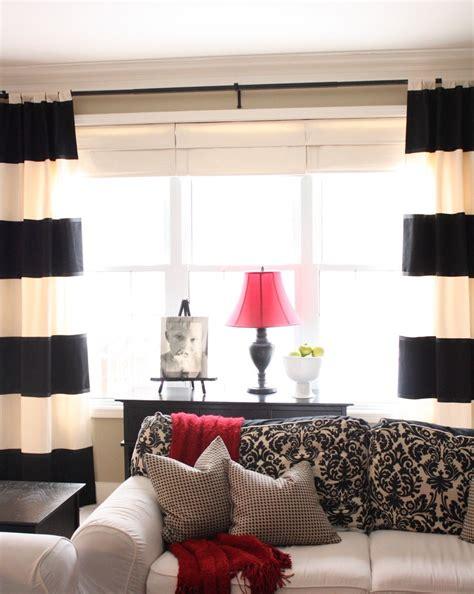 moroccan print curtains  black trim side board grey sofa