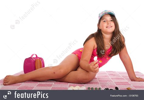 little young female models picture of girl in swimsuit playing with stones