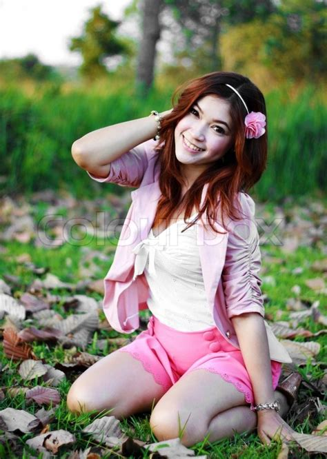 tiny pretender model japanese portrait of beautiful young asian girl in the grass