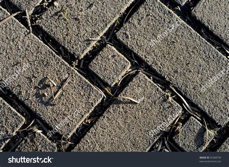 zigzag brick pattern old brick pattern in zigzag design with grass growing in