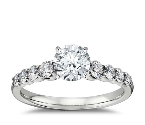 graduated side engagement ring in 14k white