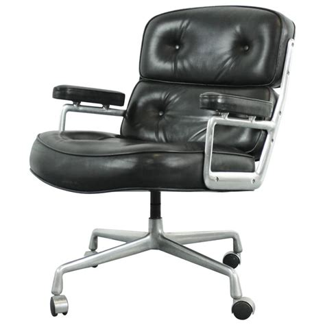 vintage midcentury black leather time chair by eames