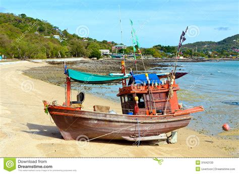 fishing boat on the beach wooden fishing boat on the beach stock photos image