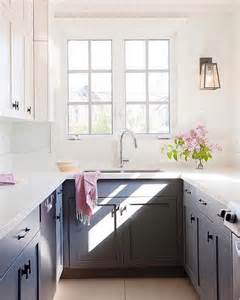 small kitchen interiors black and white kitchen with light gray tiles cottage