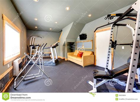 couch gym home gym with yellow couch and tv stock photo image