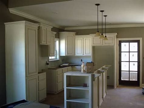 staggered kitchen cabinets staggered upper cabinet heights for the home pinterest