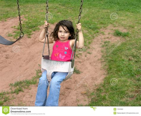 girls on swings little girl on swing stock photos image 1761953