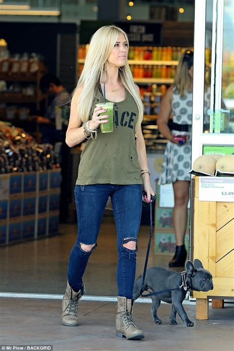 green tank and flipflops blue denim jean shorts 6 30 christina el moussa out in oc after romantic holiday