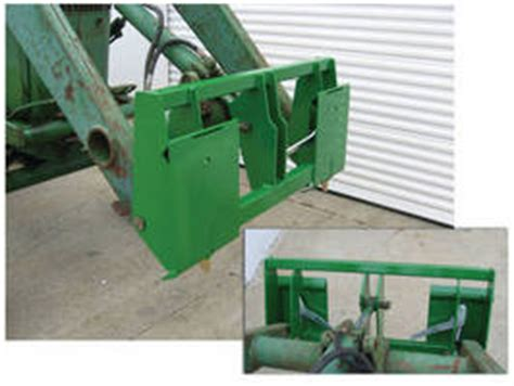 skid steer adapter adds to john deere tractor/loader