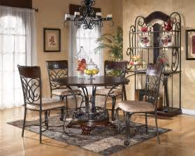 Wrought iron dining table with round wooden table top and wooden