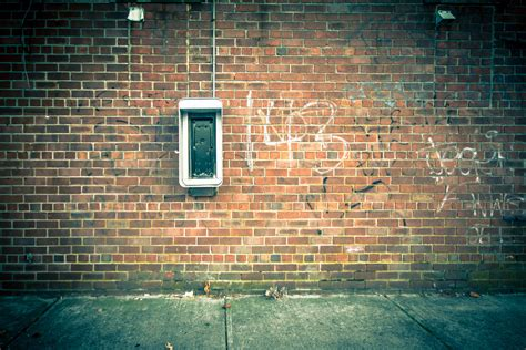Grungy urban background of a brick wall with an old out of