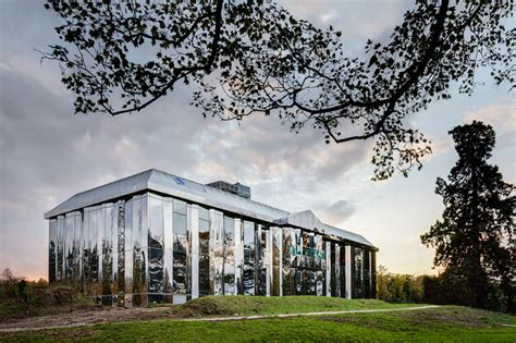 mirrored house country house re clad with polished mirrored surfaces