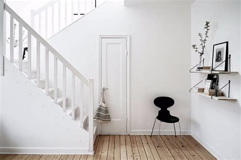 this black and white interior vision is a striking loft in scandinavian design get to know this all white design project