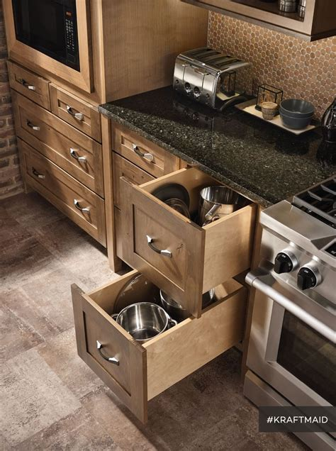 easy access kitchen storage for big pots and pans and