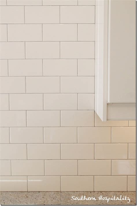 Glacier Kitchen Faucet white subway tile backsplash with gray grout