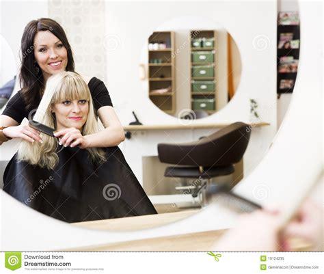 gerarda en la peluquera hairdresser and customer royalty free stock photo image 19124235