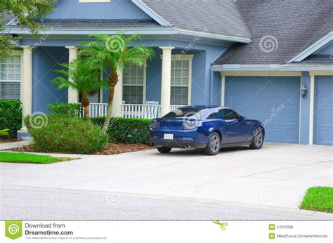 the car is in the front yard beautiful blue luxury house home with blue sports car
