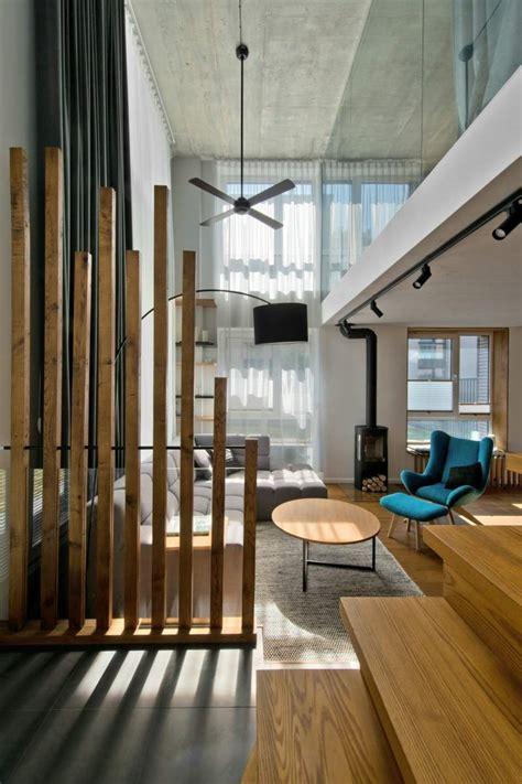 mobilier scandinave en gris blanc et bois d un loft nordique