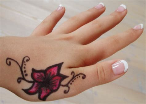 flower tattoo designs on hand 21 stylish side finger tattoos