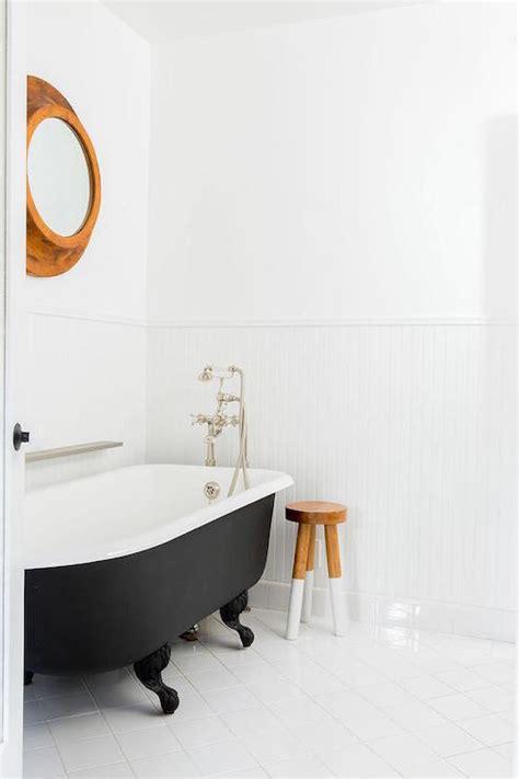 clawfoot bathtub shelf diamond pattern floor tiles vintage bathroom