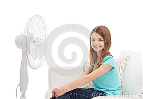 big fan home smiling with big fan at home stock photo