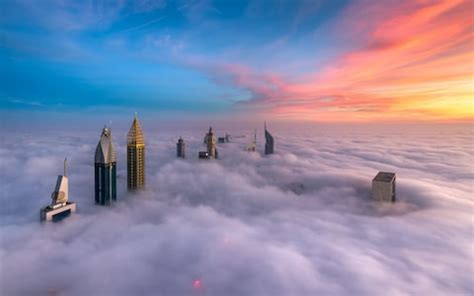 dubai's skyscrapers photographed from above the clouds, in