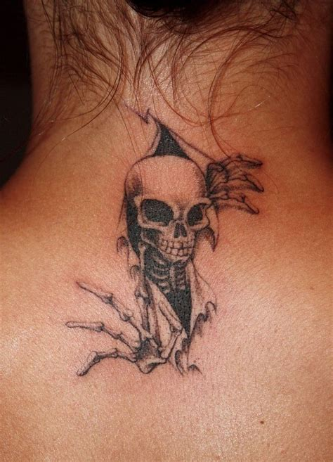 tear tattoo tearing flesh tattoos skin tearing skeleton by