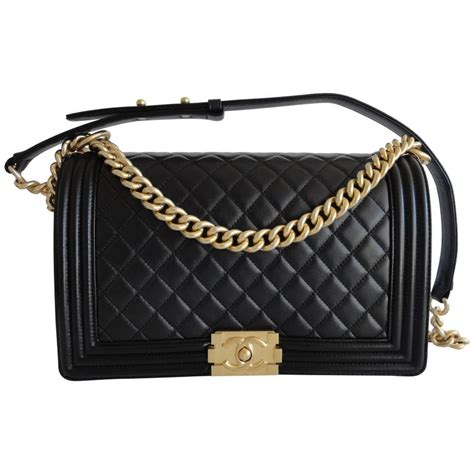 Purse Trend Black With A Touch Of Gold by Chanel Boy Bag New Medium Black Lambskin Gold Hardware At