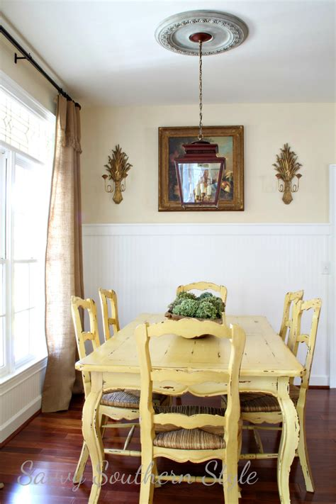 yellow dining room table at the picket fence parade of homes savvy southern style