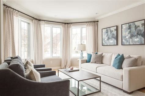 cream colored living rooms cream sofa with blue pillows transitional living room