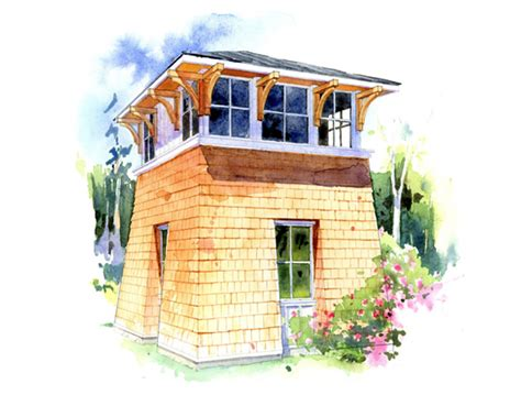 the tower studio is a small cabin with a garage on the