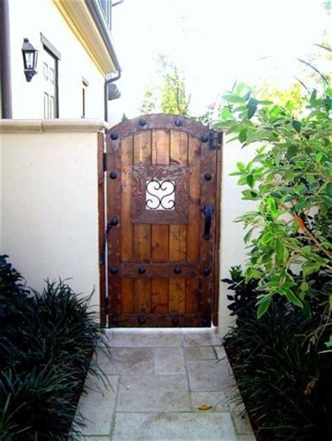 heavy wooden gates with wrought iron
