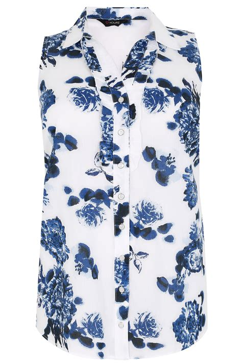 Sleeveless Floral Blouse white blue floral print sleeveless blouse with ruffle