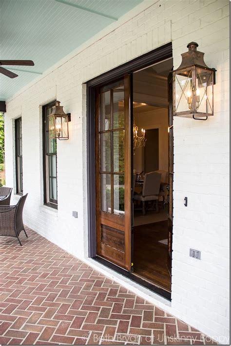 front door light fixture front porch goals love the double wooden doors and inside