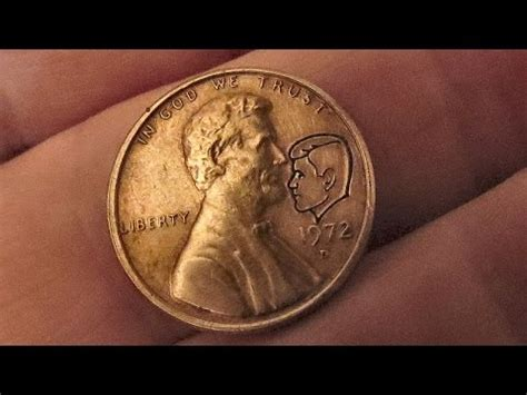 kissing coin ~ penny with jfk face ~ astonishing