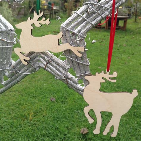 pair of prancing reindeer hanging christmas decorations by