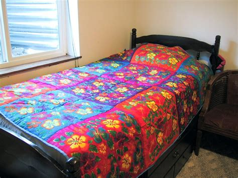 Quilt On Bed by The Many Colors Of