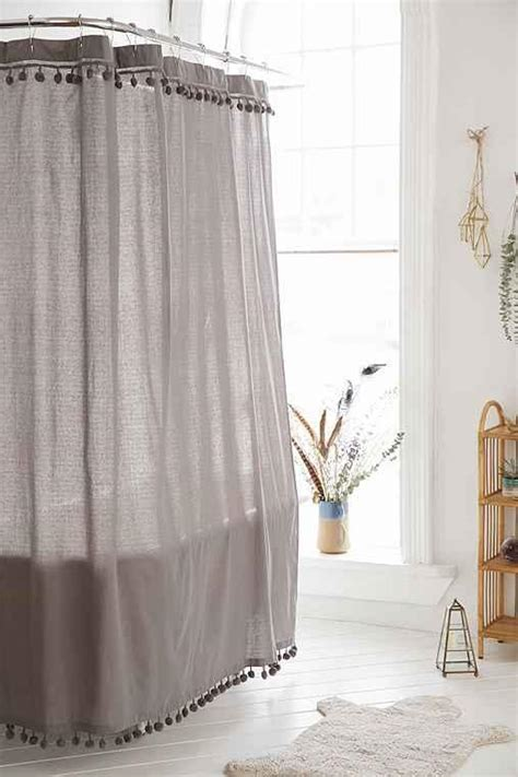 bathtub outfitters magical thinking pompom shower curtain from urban outfitters