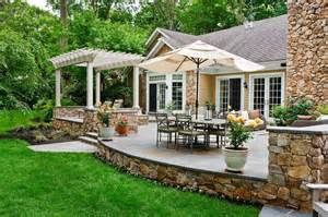 Covered Outdoor Entertaining Areas - spanish influenced raised stone patio beechwood landscape architecture hgtv