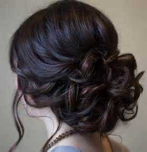 fashion forward hair up do beautiful low prom updo hairstyle with loose soft curls