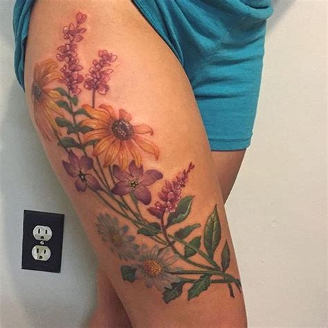 wildflower tattoo 17 best ideas about flower thigh tattoos on