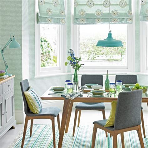mint green dining room with mid century style furniture