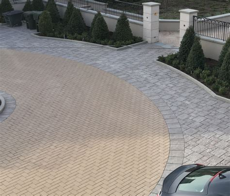 Unilock Permeable Pavers Manorial Courtyard In Wesley Ny Utilizes Unilock