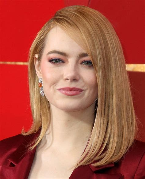 emma stone jewelry emma stone in horrid louis vuitton pantsuit and black pumps