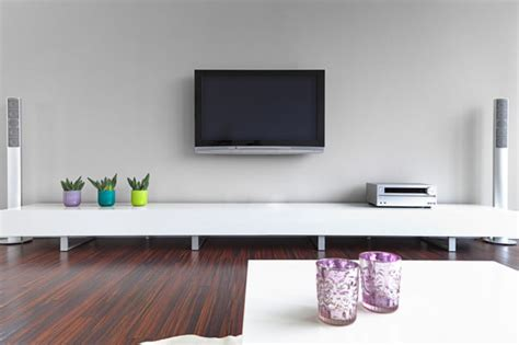 Living Room With Wall Mounted Tv Tips And Tricks For Wall Mounting Your Tv Digital Trends
